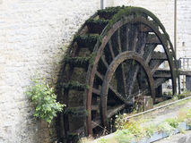 Old mill wheel in Bayeux, France. Old wooden mill wheel on the river Aure in Bayeux. Not in use anymore, these wheels are for display and touristic purposes only Stock Images