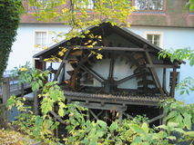 The old mill wheel in the historical center of Prague Stock Photo