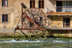 Old mill wheel in Ornans Stock Images