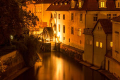 The old mill wheel in Prague in the evening in the light of lanterns Stock Photo