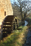 Old mill wheel and stream Stock Photos
