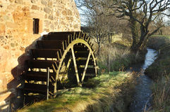 Old mill wheel and stream at Preston Mill Royalty Free Stock Images