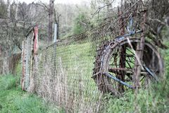 An abandoned mill wheel that contrasts with nature. stock photos