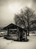 Old Mill at Winter in Italy. Old mill surrounded by snow shown in black and white royalty free stock images