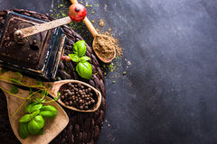 Old mill and wooden spoons with spices Royalty Free Stock Image