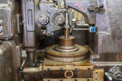 Old milling cutting run with dial gauge. And oil stain Royalty Free Stock Photos