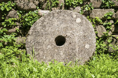 Old millstone closeup Royalty Free Stock Image