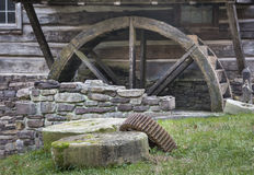 Old Millstones and Mill Wheel. Old unused watermill, and mill stones and gears in the Delaware River Valley near Bucks County, Pennsylvania Stock Images
