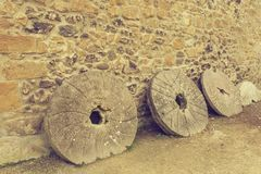 Old millstones with a vintage effect. Old millstones with vintage effect royalty free stock photo