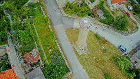 Old minaret in Drnis - aerial shot. DRNIS, CROATIA - August 16, 2014: Copter aerial view of the remains of an old minaret medieval ruins from the time when the stock video footage