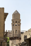 Old minaret of mosque against a bright blue sky, Islamic Cairo. Stock Photography