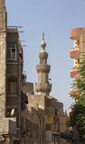Old minaret of mosque against a bright blue sky,Islamic Cairo, Egypt Stock Photos