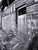 Old Mine Building. An old timber wall and door of a disused office and workshop building at the now closed gold mine, Mount Morgan Mine, Central Queensland stock photos