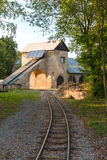 Old Mine Building with tracks. Old unused limestone mine in Bohemia, Czech Republic stock photo