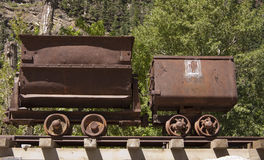 Old mine carts. Old vintage metal mining carts in the Rocky Mountains, Colorado Royalty Free Stock Photo