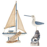 Old miniature sailboat and sea gull. Old white and blue miniature sailboat with sea gull stock photography
