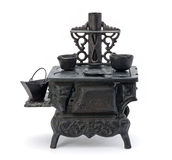 Old Miniature Stove. Isolated on a white background royalty free stock photography