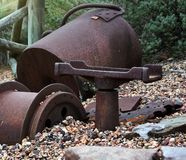 Old mining buckets in gravel royalty free stock photography