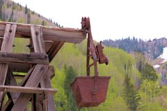Old Mining Ore Bucket. An old mining bucket proudly displayed near the base of the San Juan mountains in Telluride, Colorado Royalty Free Stock Images