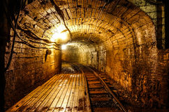 Dark mining tunnel view. Old mining tunnel interior view Royalty Free Stock Image