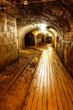 Dark and old mining tunnel view. Old mining tunnel interior view Royalty Free Stock Images