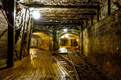 Vintage mining tunnel. Old mining tunnel interior view Stock Photos