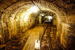 Old mining tunnel view. Old mining tunnel interior view Royalty Free Stock Photo