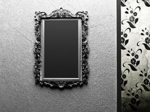 Old mirror on the dark wall Stock Photography