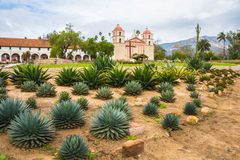 Old Mission Santa Barbara Landscape. Landscape of exterior of Queen of Missions, Old Spanish Mission Santa Barbara, in California with aloe plants in foreground royalty free stock photo