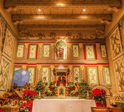 Old Mission Santa Ines Solvang California Basilica Altar Cross. Old Mission Santa Ines Basilica Altar Cross Agnes Statue Solvang California at Christmas. Founded stock photo