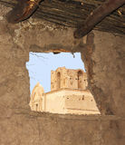 An Old Mission, Tumacacori National Historical Park. Arizona, as Seen Through the Window of a Reconstructed O'odham House stock image