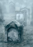 Old misty graveyard in twilight Royalty Free Stock Images