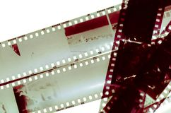 Analogic photography 35mm film. Old 35mm analogue film isolated on white stock photography