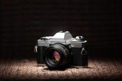 Old 35mm film camera under a spot light Stock Photo
