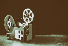Old 8mm Film Projector over wooden table and textured background Royalty Free Stock Photo