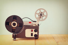 Old 8mm Film Projector over wooden table and textured background Stock Photography