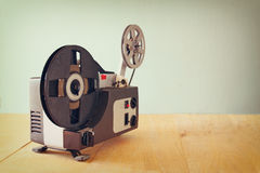 Old 8mm Film Projector over wooden table and textured background Royalty Free Stock Image