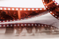 Old 35 mm twisted film Royalty Free Stock Photography