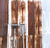 Old mob. On rusty wall royalty free stock photo