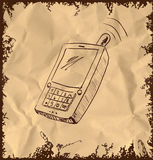 Old mobile phone on vintage background Royalty Free Stock Image