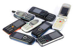 Old Mobile phones. Isolated on white stock photos