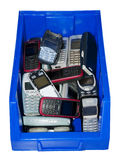 Old mobile phones in a blue box. Lots of old mobile phones in a blue box royalty free stock photo