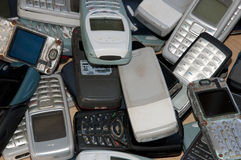 Old mobile phones graveyard. Many old mobile phone in a sort of graveyard stock photos