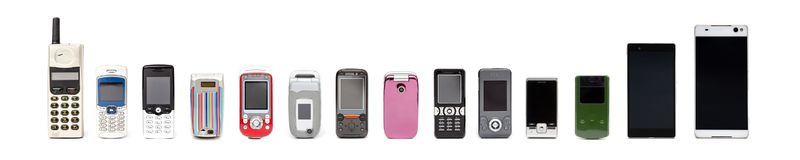 Old mobile phones from past to present on white background stock photography