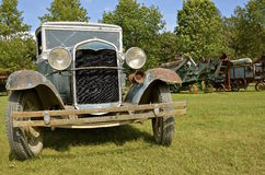 Old Model T car at threshing show. ROLLAG, MINNESOTA, September 1, 2016: The front of an old Model T Ford automobile is displayed amongst the threshing machines Stock Photo