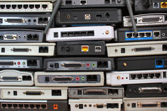 Old modems, routers, network equipment. Serial ethernet connectors. Old modems routers network equipment. Serial phone audio ethernet connectors stock images