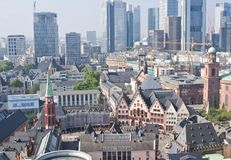 Old and modern buildings. Old city of Frankfurt with tall modern skyscrapers on background Stock Image