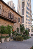 Old and modern buildings at dusk at the Sarona district, Tel Avi Royalty Free Stock Image