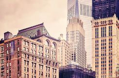 Old and modern buildings in New York City, USA. Retro stylized picture of old and modern buildings in New York City, USA Royalty Free Stock Photo