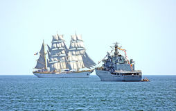 Old and modern ships. Two types of ships, an old one at left and a modern one at right Royalty Free Stock Photos